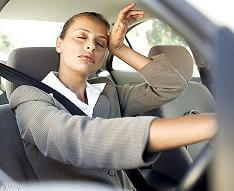a lady driving a car with basic fatigue syndrome