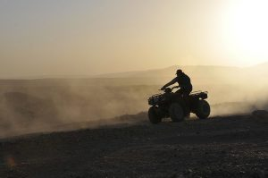 a man riding a quad bike
