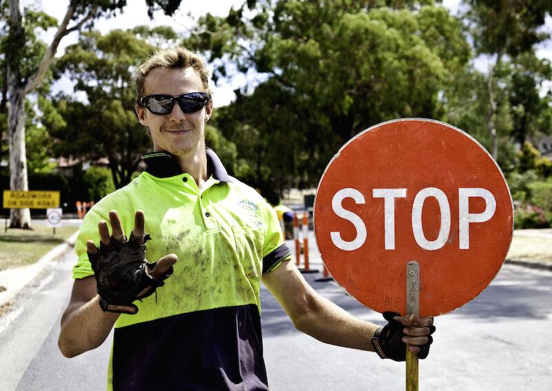 Roadworker controls traffic flow