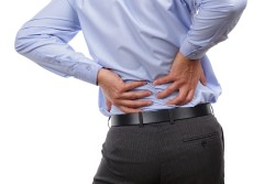 Which workers are most at risk of back pain?